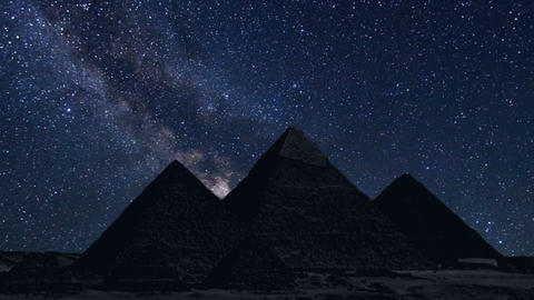 pyramids in silhouette with time lapse of stars Footage