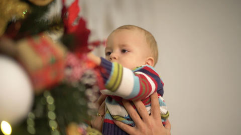Dad and baby decorates the Christmas tree. Happy family celebrates Christmas Footage