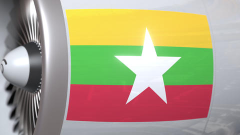 Waving flag of Myanmar on airplane tourbine engine. Aviation related 3D Footage