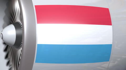 Flying flag of Luxembourg on airliner tourbine engine. Aviation related 3D Live Action
