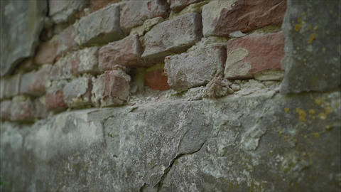 Plastered wall with exposed decaying of erosion brickwork of 18th century Live Action