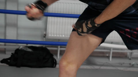 Fighter warms up his leg massaging muscles with hands before training Footage