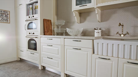 Tracking shot of a luxury kitchen with white classic design Footage