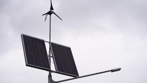 Solar panels and a small wind turbine for the production of environmentally Live Action