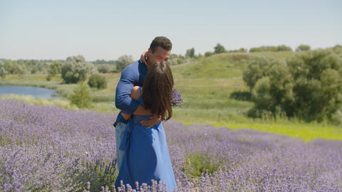 Multiethnic couple kissing in lavender field Footage