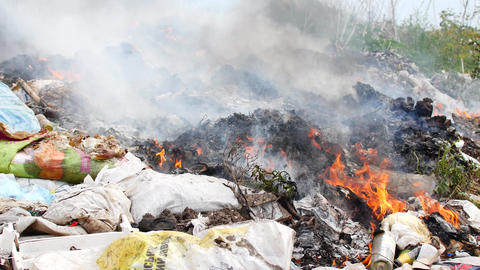 Fire at the garbage dump. Burning garbage, ecology in danger Live Action