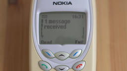 Message received. With audio. Vintage Nokia mobile phone. Old technology Footage