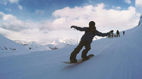 Snowboarding on a sunny day. Following camera Footage