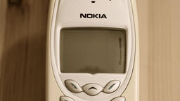 Vintage Nokia mobile phone is charging battery. Sepia ビデオ