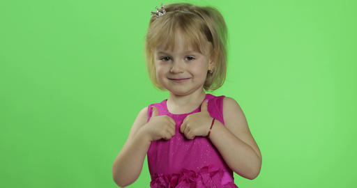 Girl in pink dress show thumbs up. Happy four years old girl. Chroma Key Footage