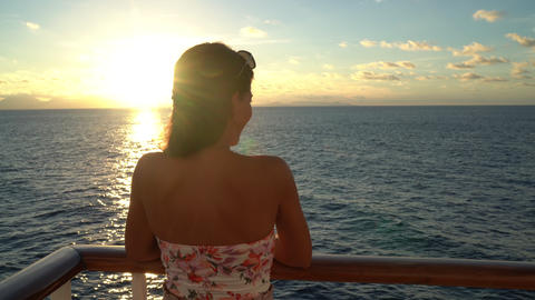 Luxury Cruise ship vacation travel woman enjoying sunset at sea on boat Footage
