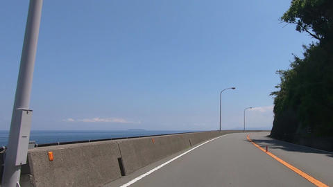 Road by the sea on a sunny day. Driving picture Footage