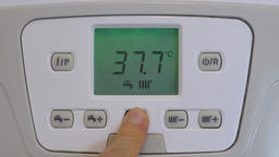 Decreasing temperature of the tap water on the gas boiler lcd display Footage