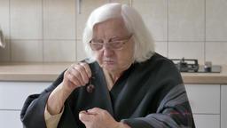 Old woman eats sweet cherries Footage