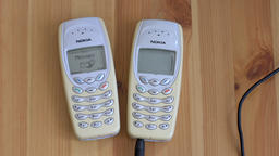 Two old Nokia 3410 Mobile phones on a table. With audio ビデオ