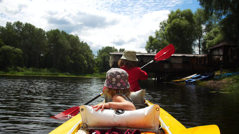 A child in a kayak on the river. Family outdoor activities Footage