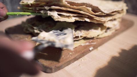Spatula smears cream in napoleon cake Footage