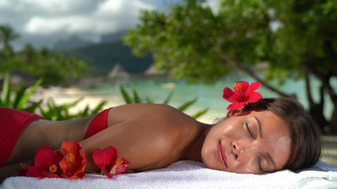 Spa Woman relaxing getting massage at hotel resort - Beauty girl Footage