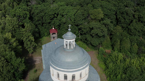 Fly drone from the old church. Drone from a bird's eye view of an old-abandoned Footage