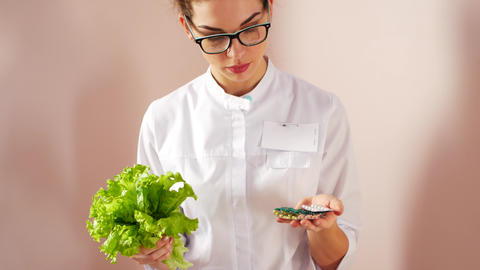 The doctor chooses between a salad or pills. Natural health concept Live Action
