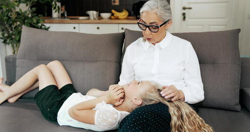 Grandmother Relaxing with Granddaughter Live Action