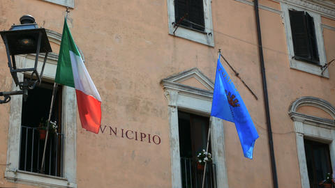 flags of Italy and Europe waving at the municipality of Nemi Footage