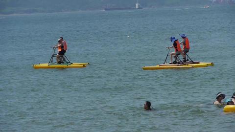 People play water bike toys on sea Stock Video Footage