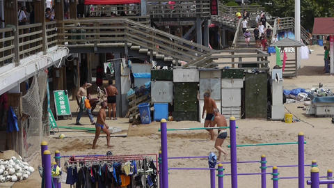people playing beach volleyball on beach Stock Video Footage