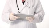 Doctor Working On A Tablet stock footage