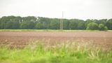 Tractor Sowing On A Ploughed Agricultural Field stock footage