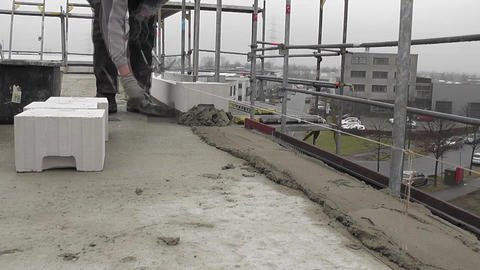 Workman on a building site laying concrete Footage