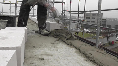 Workman on a building site laying concrete Stock Video Footage
