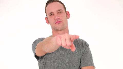Concerned Young Man Pointing Forwards stock footage