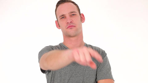 Concerned young man pointing forwards Stock Video Footage