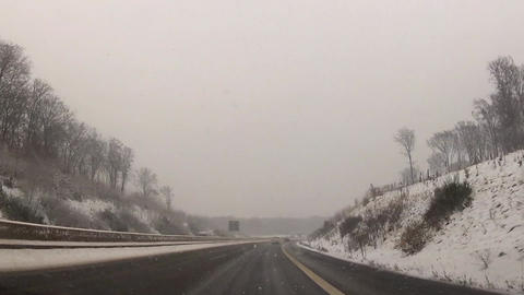 Snowstorm On A Rural Highway stock footage