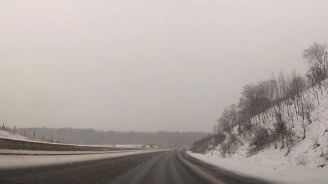 Snowstorm on a rural highway Stock Video Footage