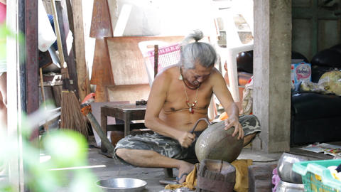 Shaping of alms bowl in Bangkok, Thailand Stock Video Footage