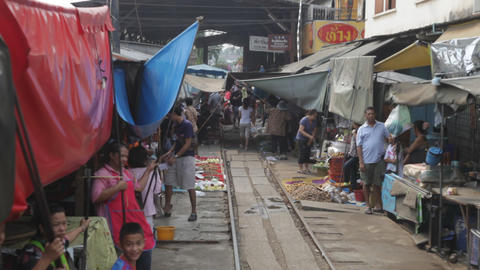 View from Train going through a Thai Market Footage