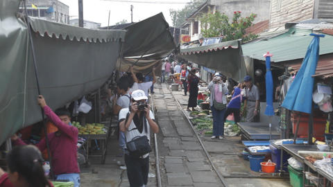 View from Train going through a Thai Market Stock Video Footage