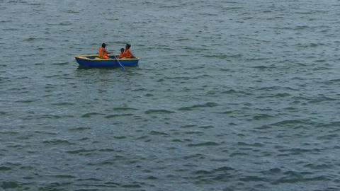 People play toy boat on sea.Toys kayaking kayak inflatable boat Footage