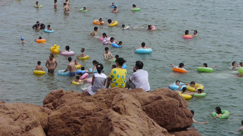 Many people swim in sea.swimming pool.A family sitting on... Stock Video Footage
