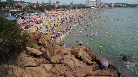 People swim in sea,A lot of people at crowded bathing sandy beach.Panoramic of C Footage