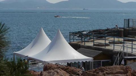 Beautiful coastal scenery & white shed.Cruise boats... Stock Video Footage