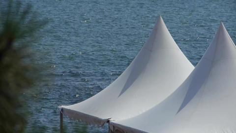 Water ripples surface & white pavilion shed Footage