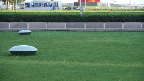 Green grass lawn & Transportation in QingDao City Stock Video Footage