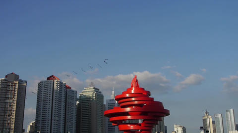 city life,kite on square,relying on high-rise buildings... Stock Video Footage