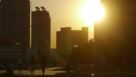city life,People walking on street,relying on high-rise buildings in sunset Footage