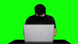 Hacker Working Table Getting Slaps Greenscren 5 Stock Video Footage