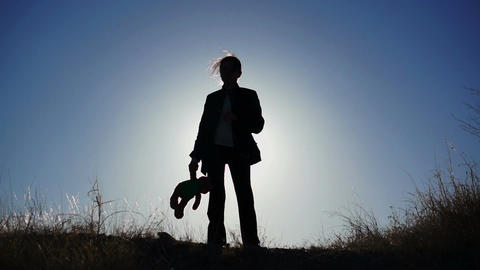 Silhouette of Girl with Teddy Bear Stock Video Footage