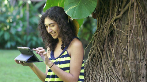 Teenage girl using a tablet Stock Video Footage